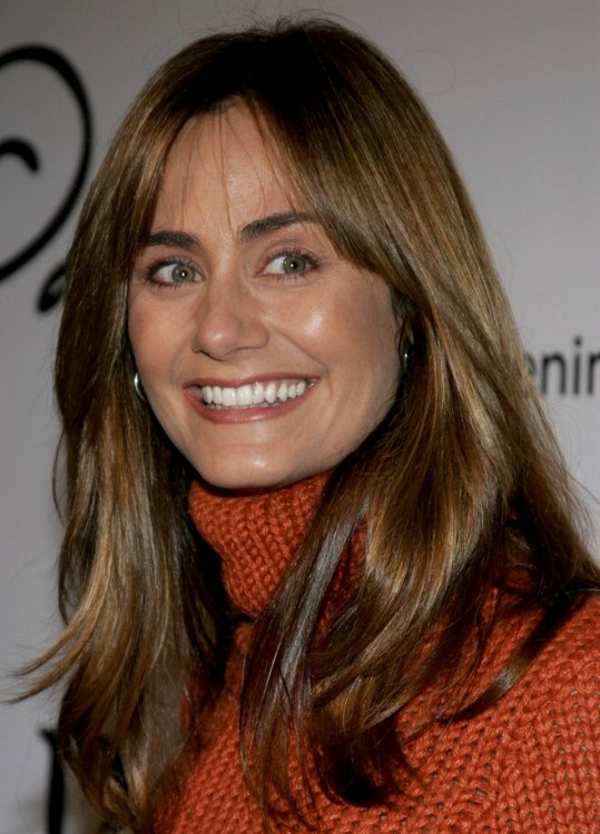 Diane Farr  Natural looking hairstyle with side bangs for