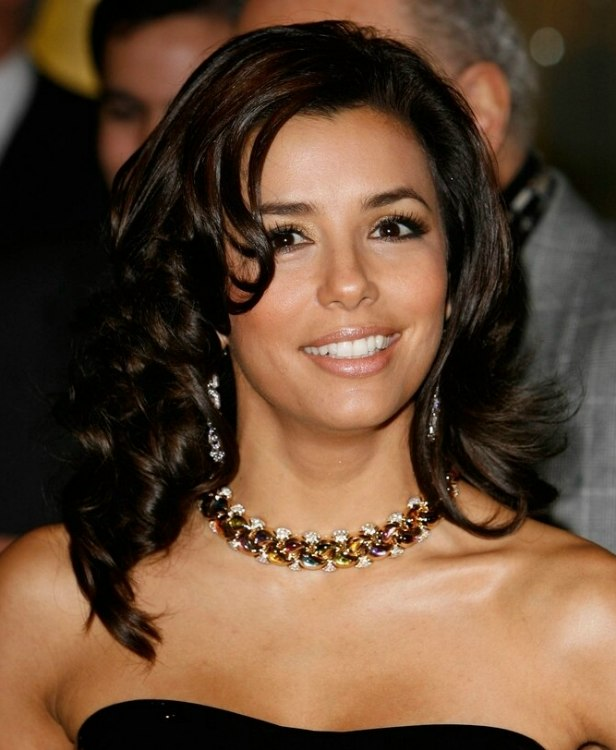 Eva Longoria  Long and bouncy center of the back hairstyle with volume
