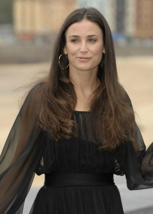 Demi Moore  Long center parted hairstyle for a square face and a long neck