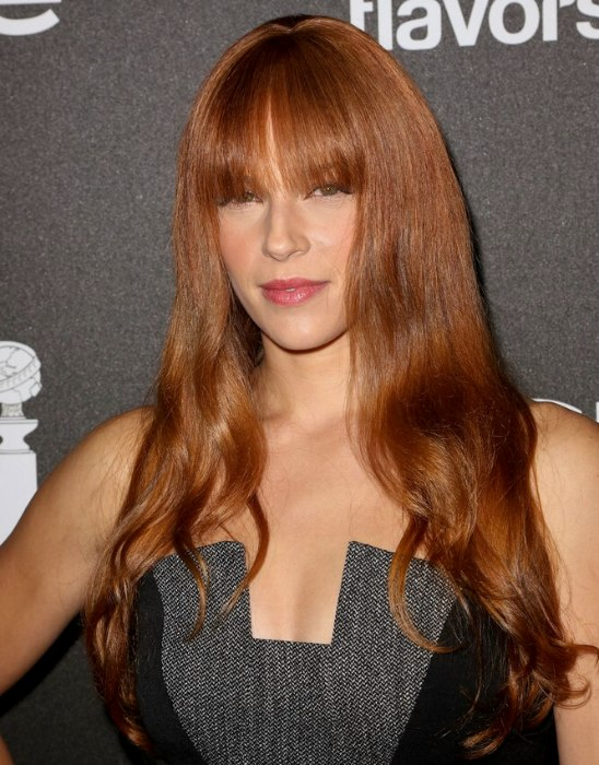 Amanda Righetti  Girly bustline length hairstyle with blunt bangs for coppery hair