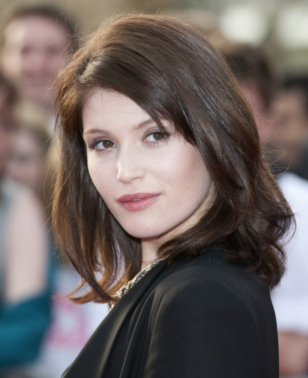 Gemma Arterton  Hairstyle with length around the shoulders and bangs styled to expose the face