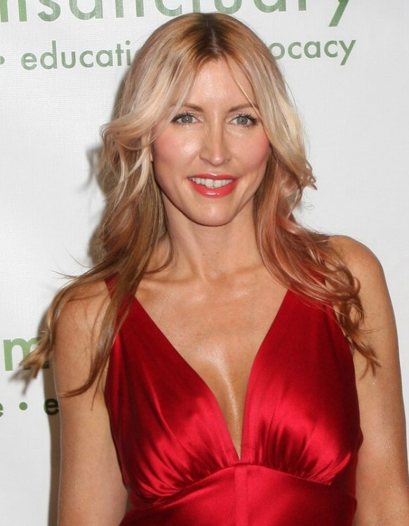 Heather Mills  Long loose hairstyle upon the back and below the shoulders