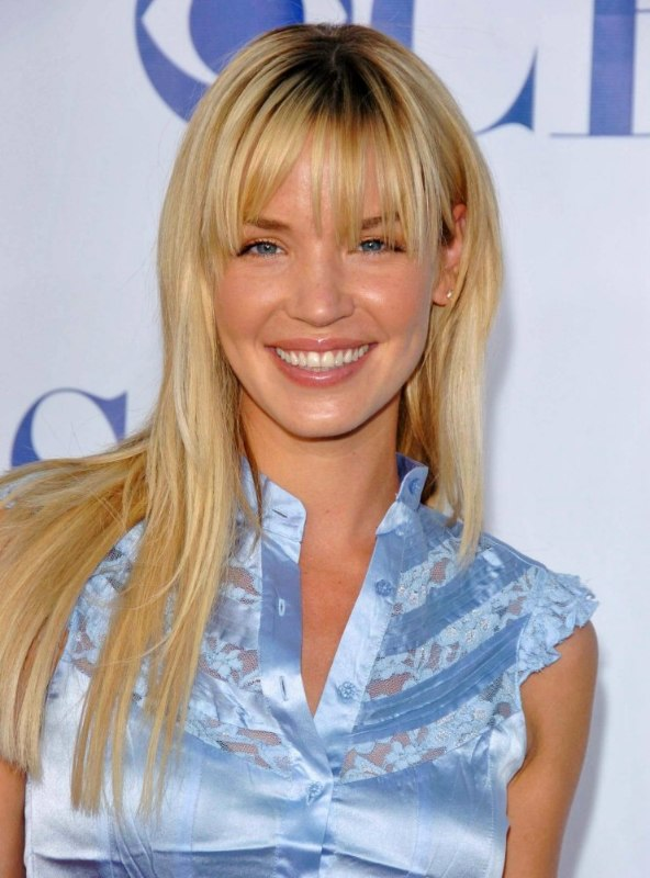 Ashley Scott  Sleek long hair with thick pieced out bangs to camouflage a longer forehead