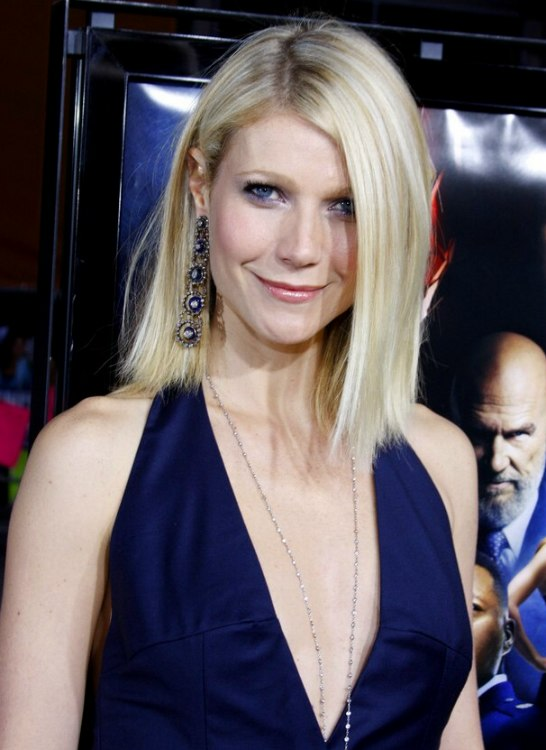 Gwyneth Paltrow  Straight shoulder line haircut with hair tucked behind one ear