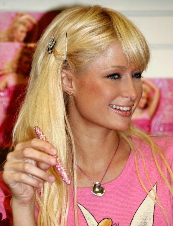 Paris Hiltons Barbie hairdo with long hair and hair pins