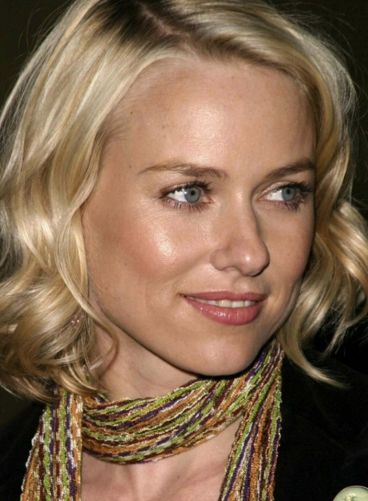 Naomi Watts wearing her hair in a shoulder length bob with curls