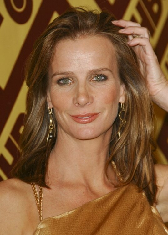 Rachel Griffiths  Natural looking blonde hair brushed away to reveal her face