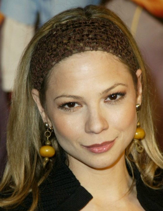 Tamara Braun  Cheerleader hairstyle with flipping sides and layered hair with a hair band
