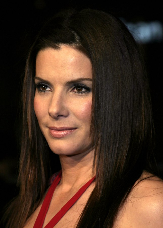 Sandra Bullock wearing her long hair sleek super straight