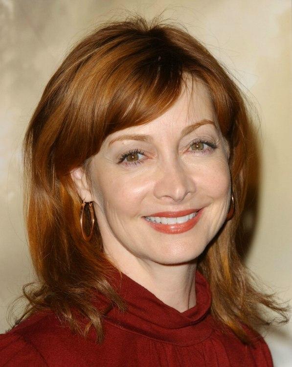 Sharon Lawrence  Medium long auburn hair with soft volume