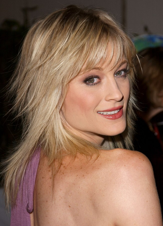 Teri Polo  Long straightened hair and long hair with jagged textured ends