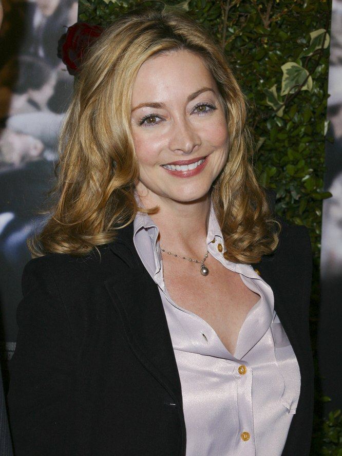 Sharon Lawrence wearing a silk shirt  Long hair with