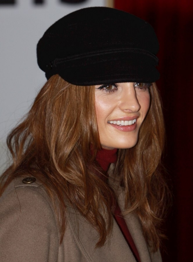 Stana Katic with long hair and wearing a chauffeur style