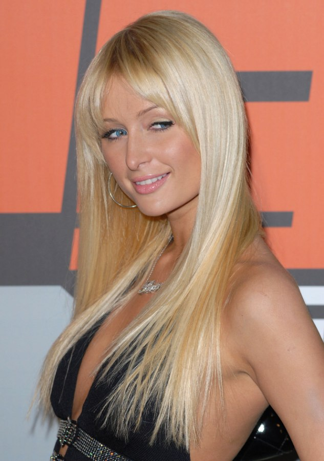 Paris Hilton wearing her hair smooth with extensions
