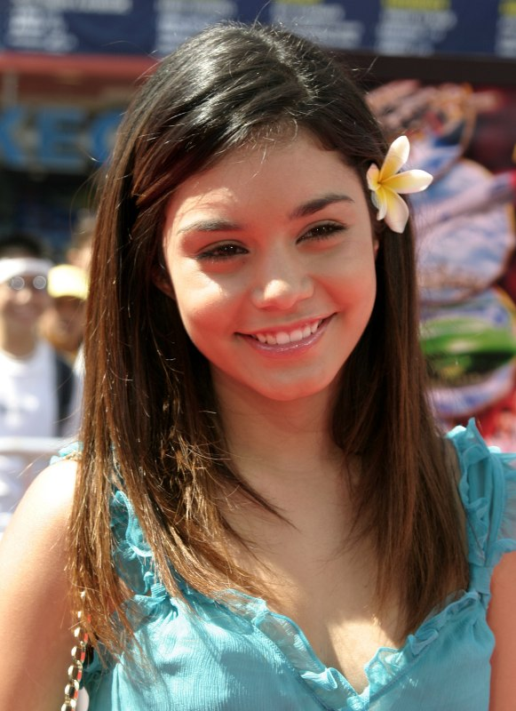 Vanessa Hudgens Wearing A Flower In Her Straight Hair And