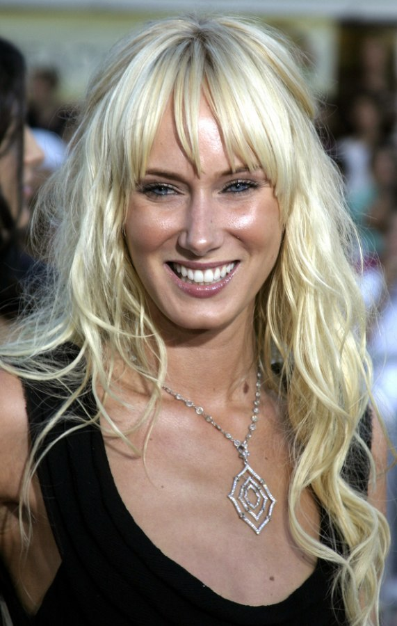 Kimberly Stewart wearing waist long hair with a pinned section at the back