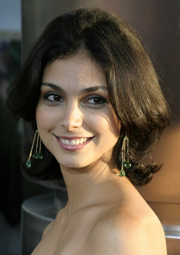 Morena Baccarins medium length hair with the back flipping up around the neckline
