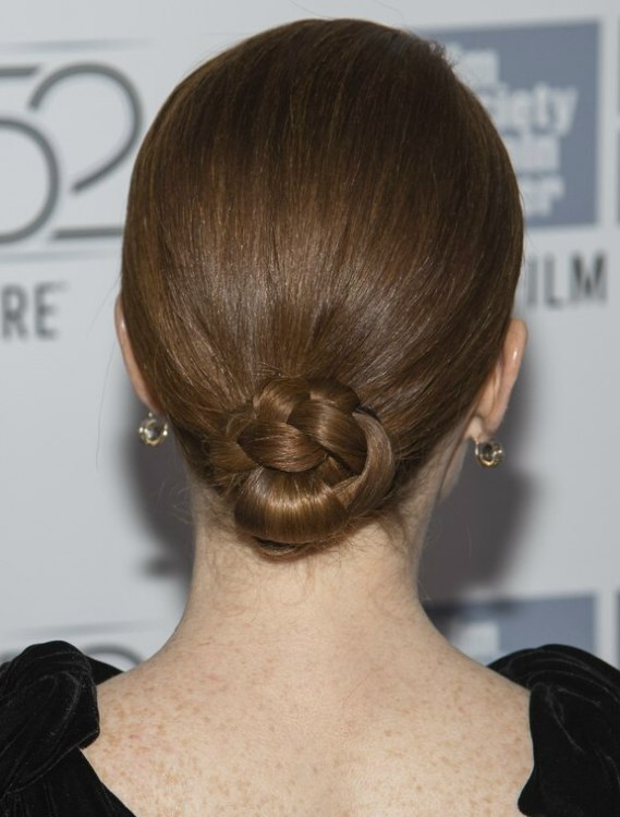 Julianne Moore wearing her sleek hair drawn back and styled into a chignon