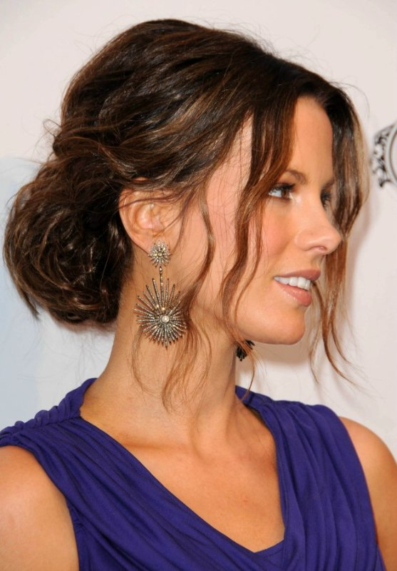 Kate Beckinsale with her hair pulled into a simple updo with a laidback vibe