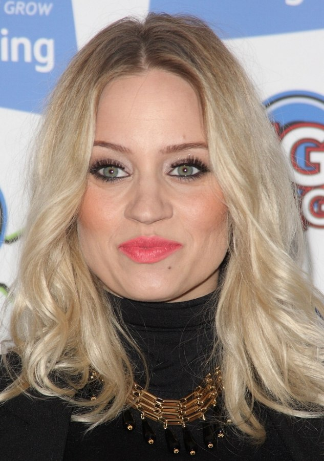 Pregnant Kimberly Wyatt With Her Hair Curled Away From Her