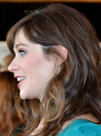 Zooey Deschanel's long curled hair with a retro feel