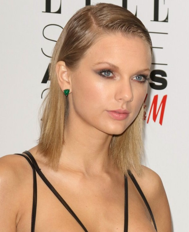 Taylor Swift wearing her hair side parted and slicked back