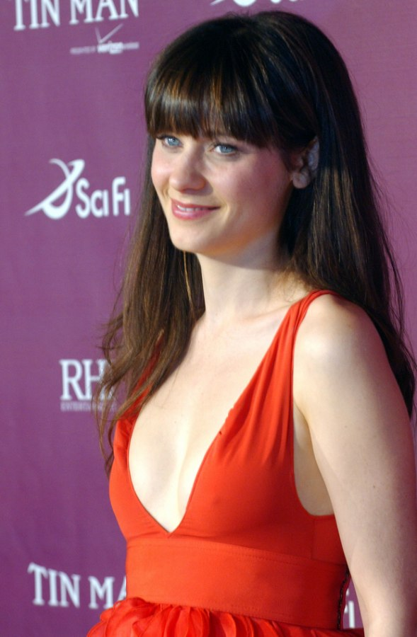 Zooey Deschanel wearing her thick midback hair sleek with blunt cut bangs