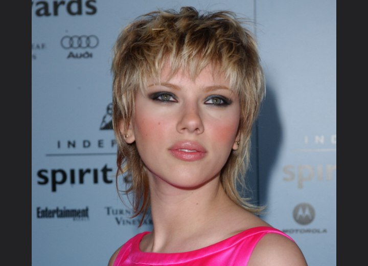 Scarlett Johansson  Shaggy 80s hairstyle with a long textured neck