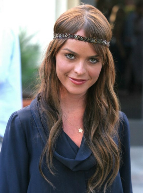 Taryn Mannings long 60s hairstyle with a retro headband