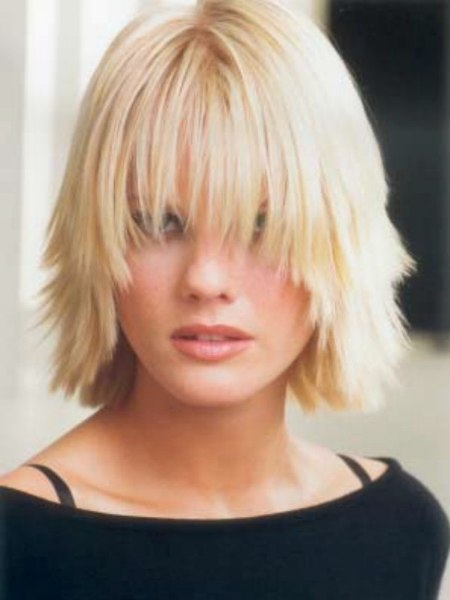 Medium Hairstyle With Chunky Layers And A Curved Fringe