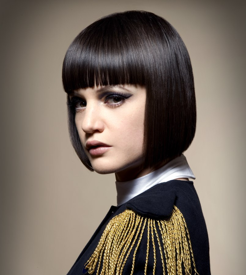 Smooth Chin Length Bob With A Blunt Fringe And Ends With