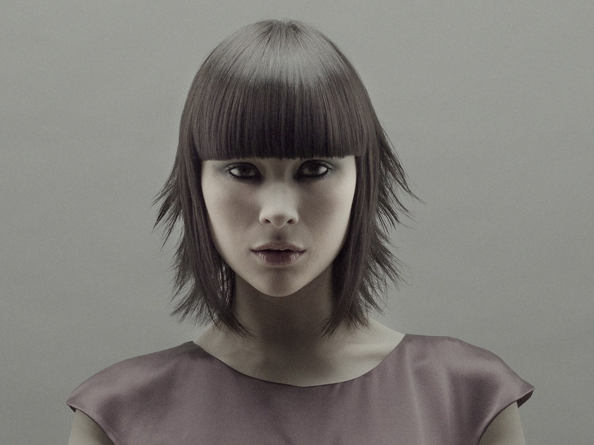 Neck Length Bob With A Blunt Horizontal Fringe And An