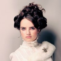 Victorian updo with plaited and rutched hair