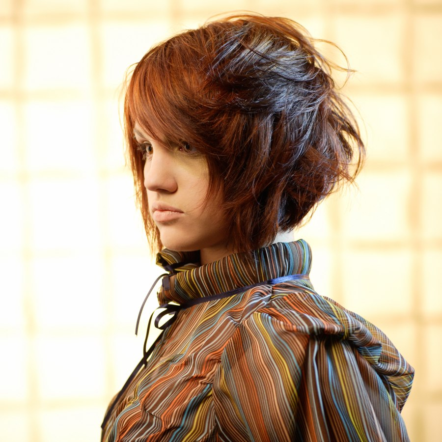 A Line Bob Cut With Choppy Layering And A Wind Swept Effect