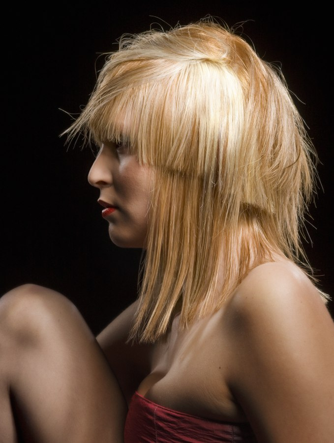Shoulder length bob with overcut layers and a blunt