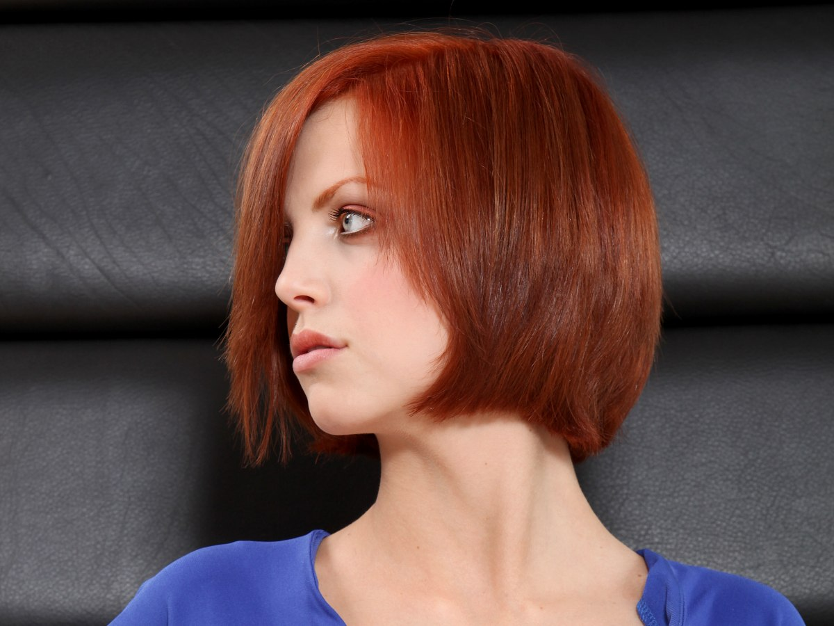 Short Chin Length Bob With An Edge That Curves In Warm