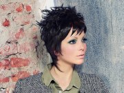 black pixie hairstyle with feathery