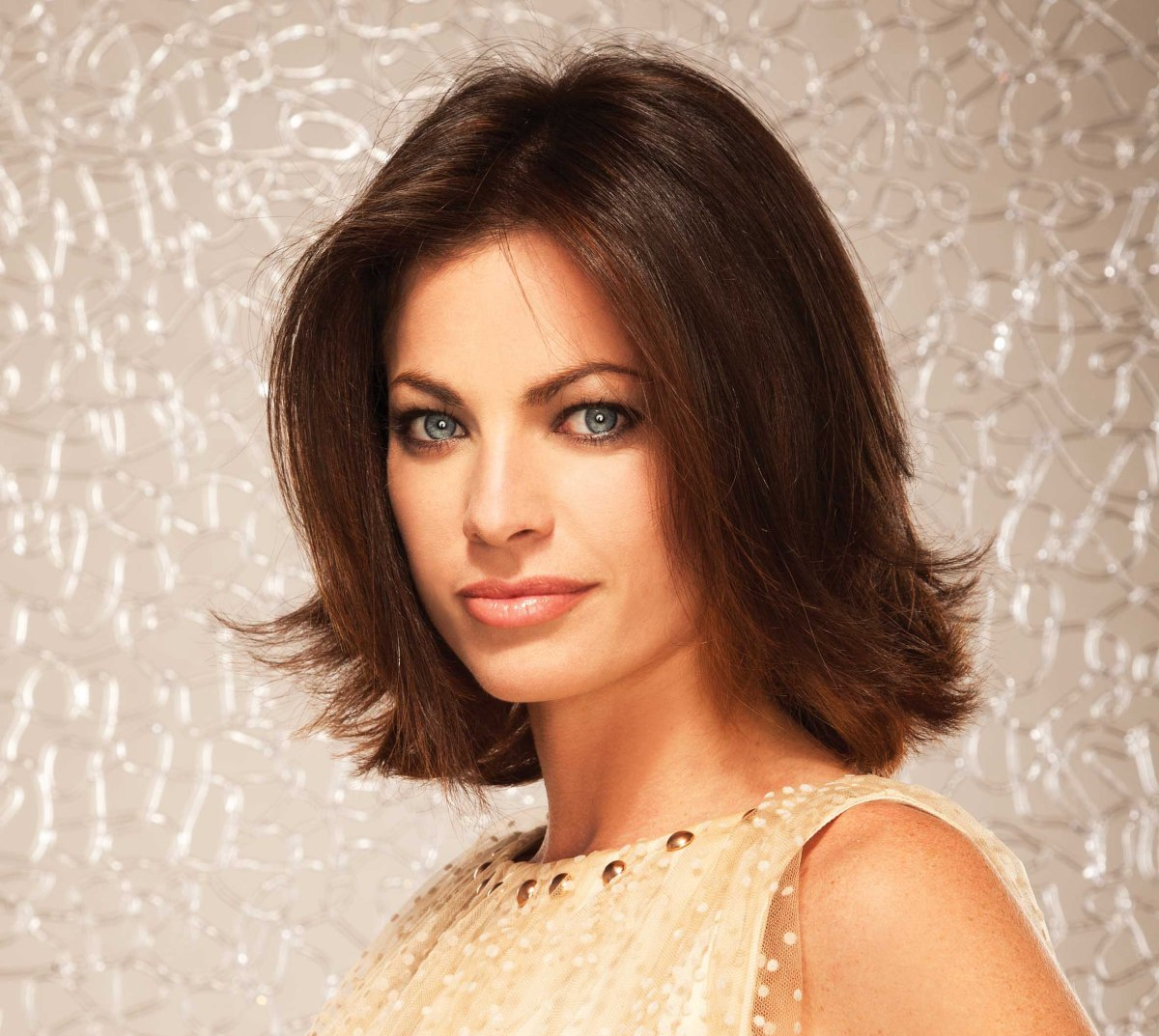 Soft long brunette bob with the tips turned outward