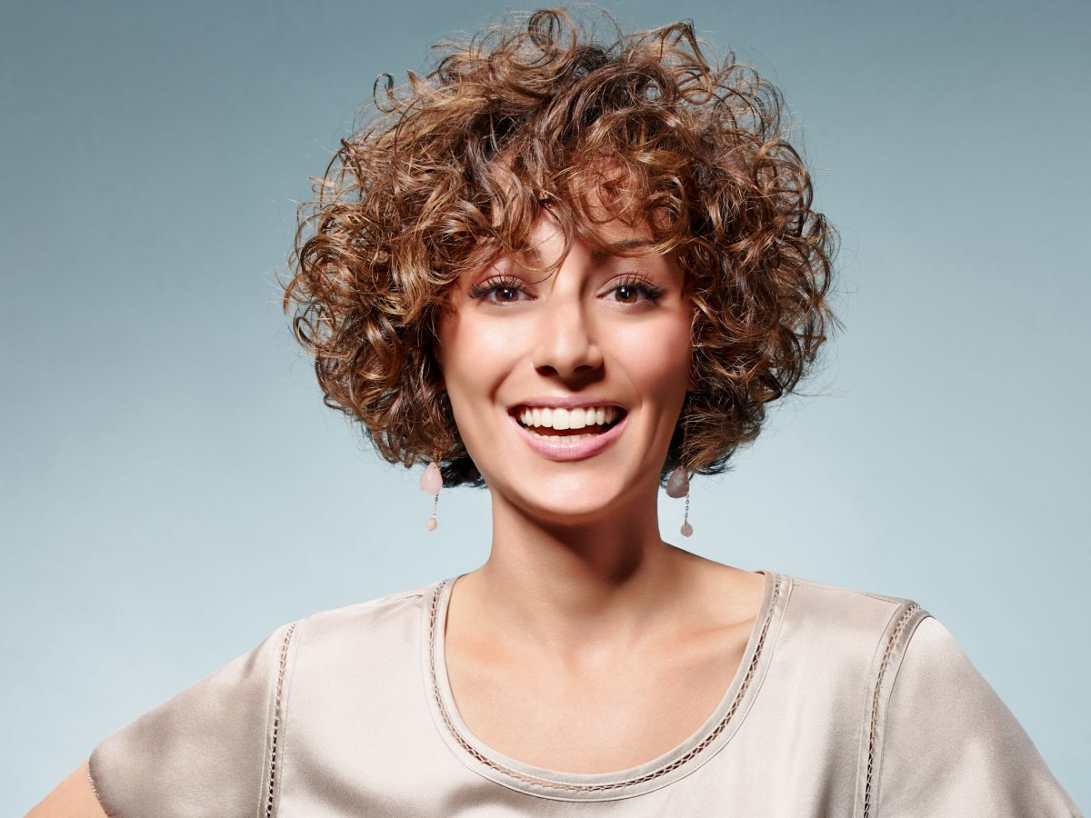 Fresh Short Hairstyle With Happy Small Curls And A Round Shape