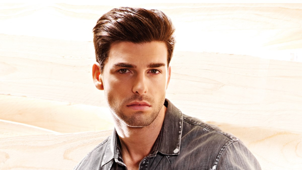 Guys hair fashion with short sides and a longer top