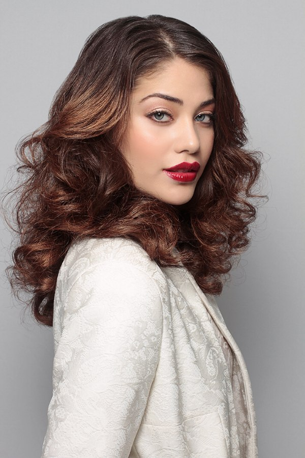 Long Hairstyle With Thick Volume And Curls That Cascade