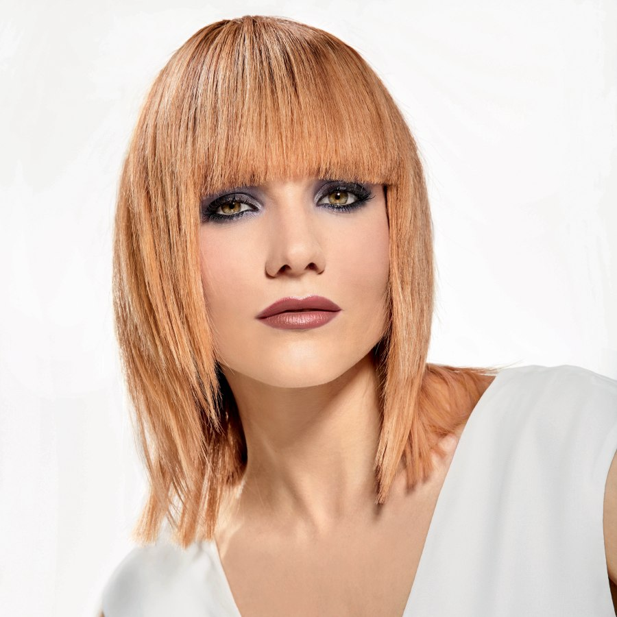 Hairstyle With Bangs Sharp Angles And Tapered Sides