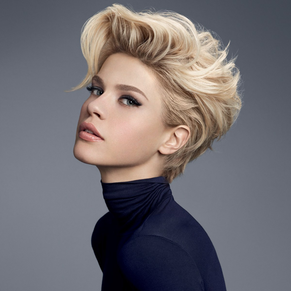 Short haircut with high volume and messy styling  Turtleneck