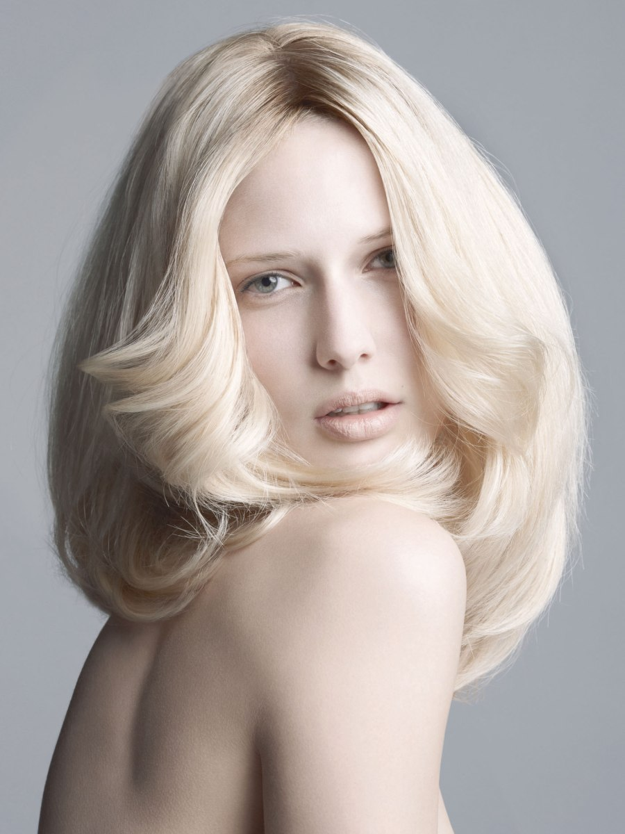 Modernized Farah Fawcett Hairstyle For A Feathered Back Look