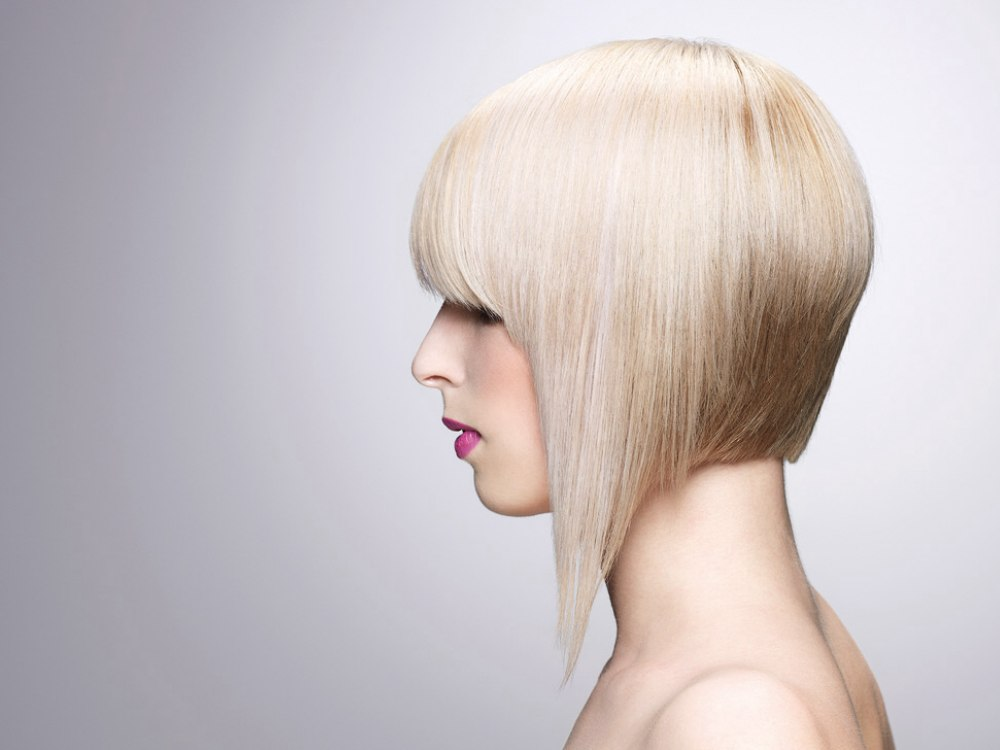 Blonde Aline bob haircut with one extended and pointy length