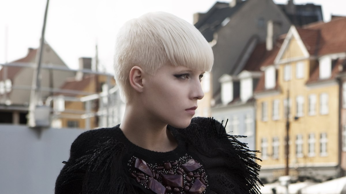 Short cropped blond hair with a full fringe