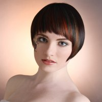 Smooth short hairstyle with a fringe and color applied in ...