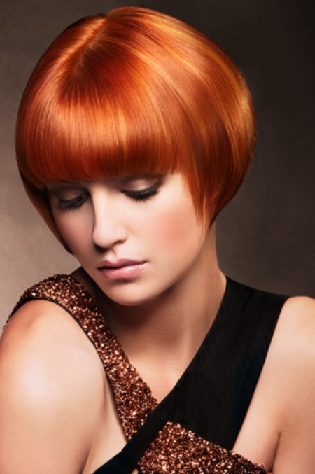 Short and sleek red hair cut for a snug fit