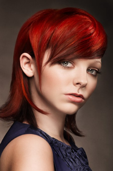 Bright ruby red hair cut in a refined and sophisticated shape