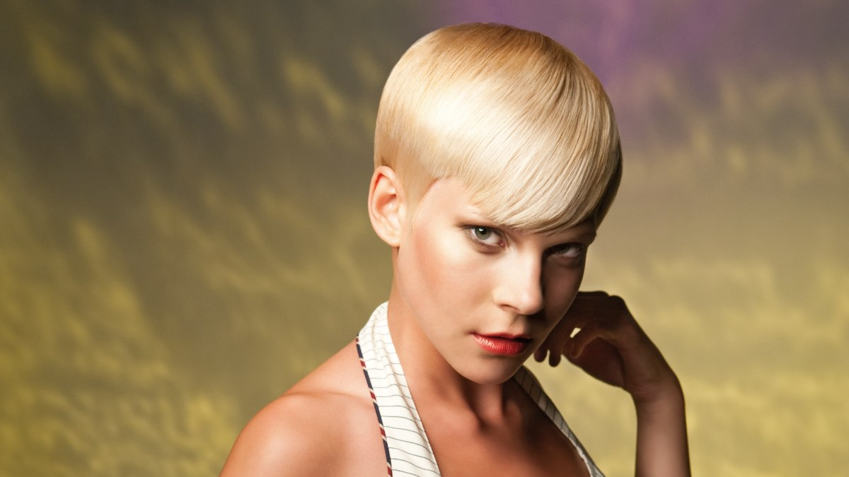 Short And Sleek Gamine Cut With Curved Bangs For Boyish Charm